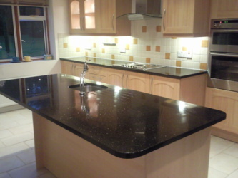 Star Galaxy granite island in Camberley Surrey. Makeover with new tops, sink and tap.