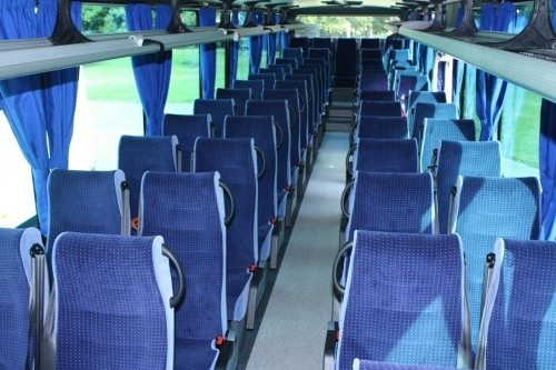 This shot shows the interior of our 57 seater vehicles with  2 Doors.