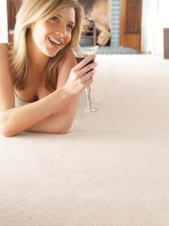 One of our Glamourous Sales Assistants demonstrating the correct way to hold a glass of Red wine over your new carpet!