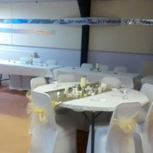Function hall dressed for wedding reception