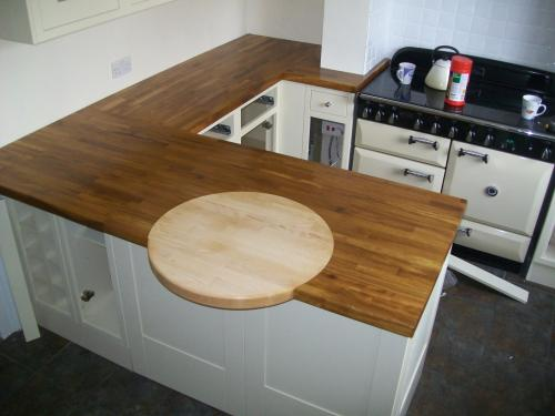 Solid wood, Iroko with a circle of Beech set in as a small breakfast bar