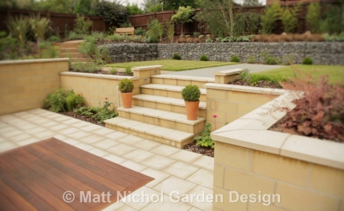 Stone steps and inset hardwood decking.