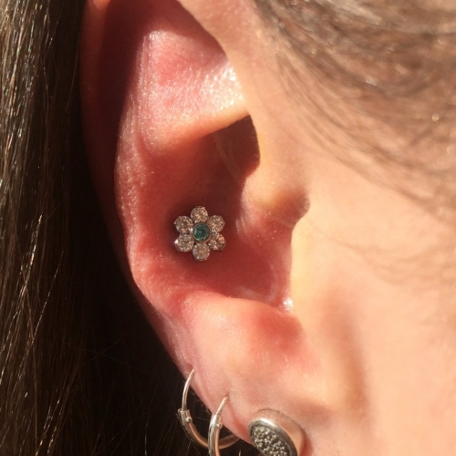 Pretty conch piercing by Mara