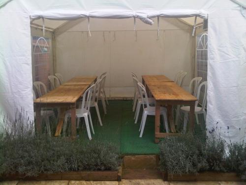 Trestle tables in a 4m x 4m wide party marquee Marquee Hire Peterborough