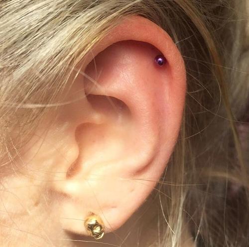 Helix piercing by Mara