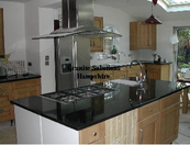 Large granite island and Absolute Black granite worktops in East Sussex.