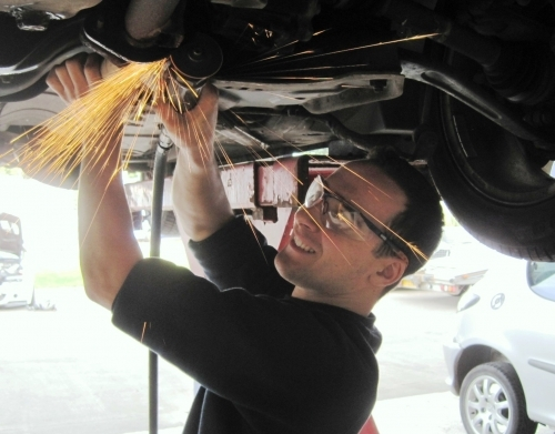 Technician working on car