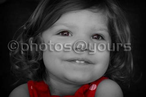 black and white portrait of little girl with red dress colour popped