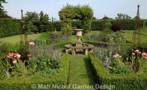 Wonderful herbaceous planting in a formal garden, Cheshire.