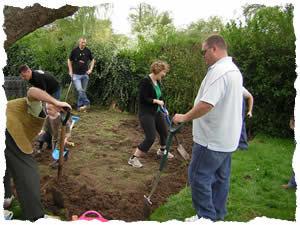 Parents help prepare the veg patch