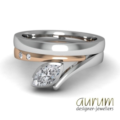 Flick ring with marquise diamond in platinum and red gold shown with a platinum wedding ring