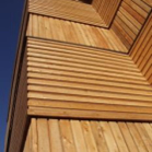 Alternating horizontal and vertical timber cladding