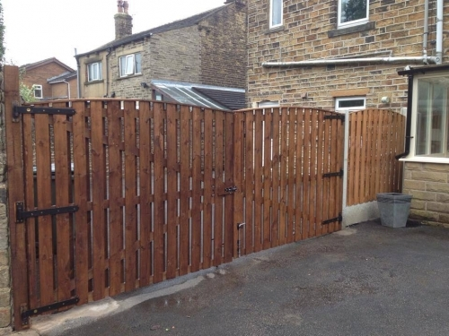 bespoke fencing and gates - made to measuse - concrete posts - wood