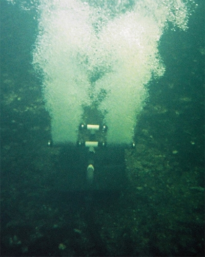 Airpro Diffused Aeration System operating underwater to help increase the dissolved oxygen levels in a lake