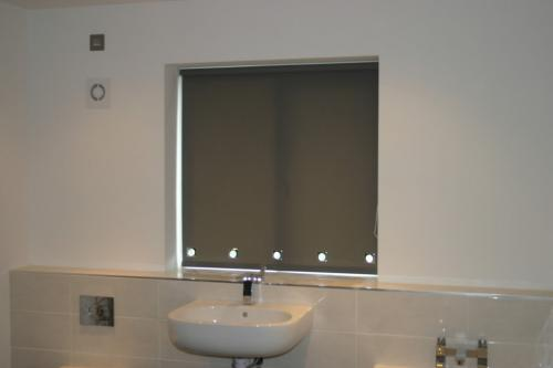 Roller Blinds with Eyelets
