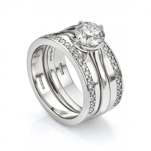 Platinum diamond engagement ring and shaped wedding ring set