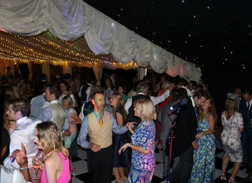 Wedding Disco Guests Dancing In Marquee