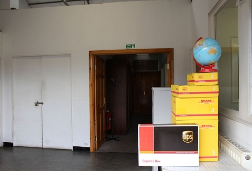 This image shows a view of the globe and the boxes used by some of the carriers that we are in partnership with. It also shows a bit of the view of the office lobby.