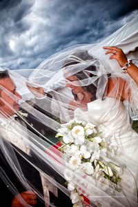 Fun wedding picture on a stormy night outside their marquee wedding in North Yorkshire