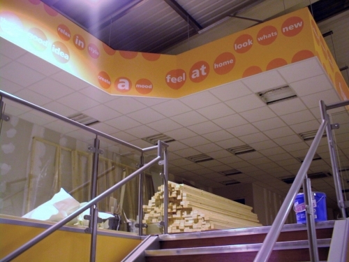 Suspended ceiling with plasterboard bulkhead.