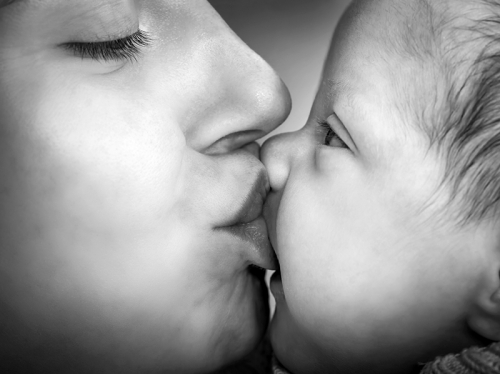 Mother Kissing Newborn