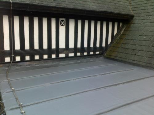 Imitation lead flat roof.