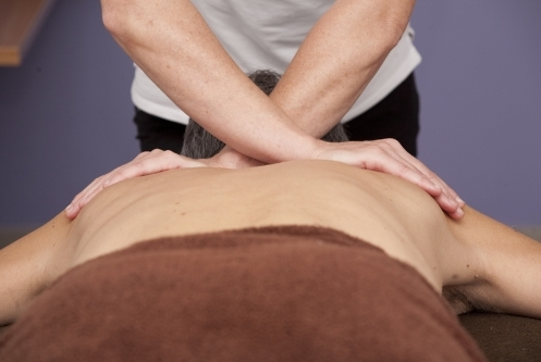 Sports massage to upper back.