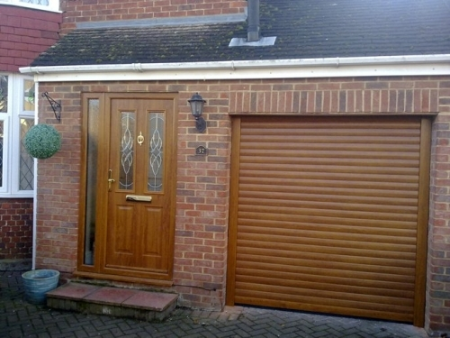 Insulated Roller Garage Door laminated in golden oak