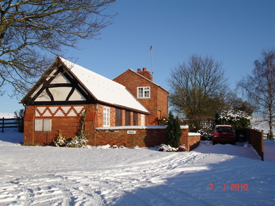 Beagle cottage in the snow