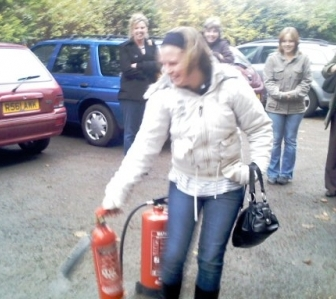 Fire Safety with handbag in Rugby