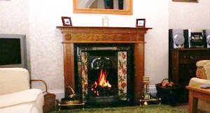 The log fire in the comfortable lounge at Rockvale