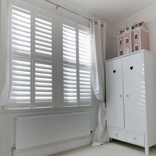 White Shutters In A Bedroom