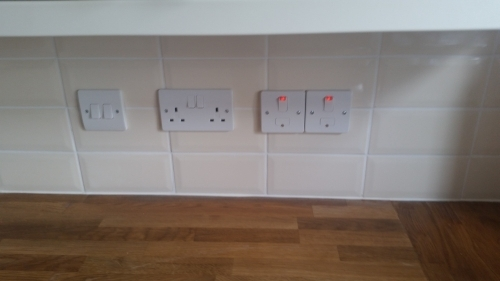 Installation of 2-gang switch, twin socket and two switched fused spurs above kitchen worktop